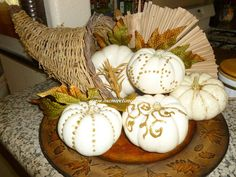 White Pumpkins decorated with gold glitter glue