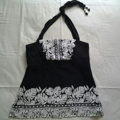 Beautiful Silk Halter Top A dressy black and white halter with tie-around neck accent. Left side zipper closure. Boning in front. Side slits. Shell 100% silk. Lining 100% polyester. Only worn once. White House Black Market Tops