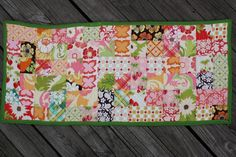 At the beginning of the year, I won a wonderful 22-square charm pack fromSeaside Stitches. The fabrics were from Sandi Henderson's Meadowsweet line. I finally figured out what to make with them, so I thought I would share what I did in this one-evening project! Table Runner Finished size: 28″ x 12″ Materials – 21 …