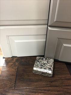 New Caledonia Granite | Painted Linen Rushmore cabinets | Gray Rushmore cabinet | Tumbleweed  hardwood floors
