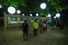 Outdoor photo exhibition (photovoice sumba) with lampion hanging at Lambanapu, East Sumba