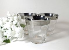 Silver band tumblers indicative of the mid century era. The dimensions, flared…