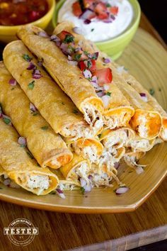 Crockpot Cream Cheese Taquitos - Use your crockpot to make this moist flavorful creamy chicken. Fill flour or corn tortillas with cream cheese chicken and cheese, bake and enjoy! These are fantastic!