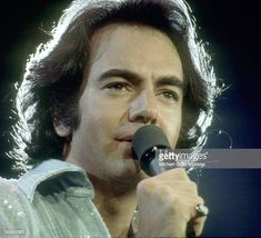 Singer Neil Diamond performs onstage wearing a sequin shirt in circa 1977 in Los Angeles, California. Get premium, high resolution news photos at Getty Images Neal Diamond, Diamond Girl, Stock Pictures, Stock Photos, The Jazz Singer, Perry Como, Sequin Shirt, Los Angeles California, Sequins