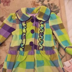 2T girls soft fleece multi-color jacket! New Brand-new size2T girls jacket ruffle front - colors: purple, turquoise, lime green with fold up cuffed sleeves. New with tags. It was part of a 3 pc, but only have jacket- the best piece. Pair it with purple leggings! Kids Headquarters Jackets & Coats