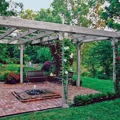 A freestanding pergola and outdoor fire pit make t...