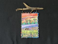 Tree Line.  A small art quilt hanging from found driftwood.