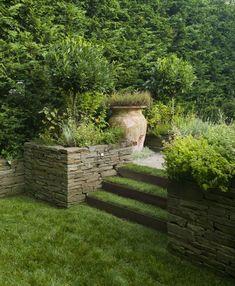 Bluestone Retaining Walls   ... stacked bluestone walls serve as planters as well as retaining walls