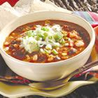 Chicken Tortilla Soup - Quick, easy, hearty and delicious. I like it topped with crushed tortilla chips, shredded cheese, and a bit of sour cream.