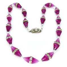 An incredibly beautiful original Art Deco necklace in a rare pink colour way. The necklace features faceted pink glass beads with paste rondelle...
