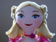 Her embroidered face is smiling---- very sweet. def doing an embroidered face for jam's doll