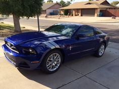 File:2014 Mustang Premium Coupe in Deep Impact Blue with Pony Package 1.JPG