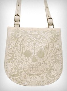 Cross-body messenger bag with Dia de Los Muertos embossing.