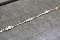 Dainty pearl and crystal beaded bracelet with gold by SCBeads