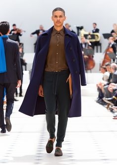 Burberry Spring/Summer 2016. Ink blue double wool topcoat, textured leather document case in bright toffee and ebony suede loafers with contrast green tassels
