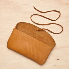 Palomino Wrap Clutch by Stitch & Hammer $44 Save 20% off with code LOVELDL