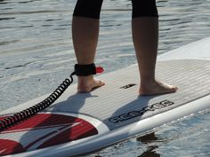 To keep your board from slipping away if you should tumble off, make sure your paddleboard is strapped to your ankle. Velcro allows you to slip the security line on in seconds.