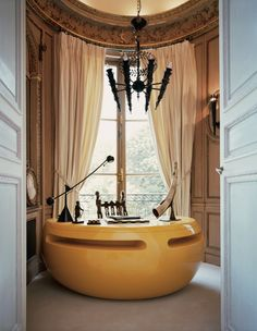 Yves Gastou, Paris:desk by Maurice Calka (1960), Chandelier and sconces by Poillerat Gilbert (1940)