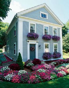 Window boxes and flowers-- cutest house ever, not over the top big or small, just simply cute