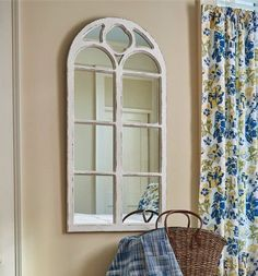 """This window inspired mirror has distressed white finish and an arched top. Made from wood and glass, this is a lovely addition to any wall. Accessories not included. Dimensions: 47.25"""" height x 23.5""""                                                                                                                                                                                  More"""