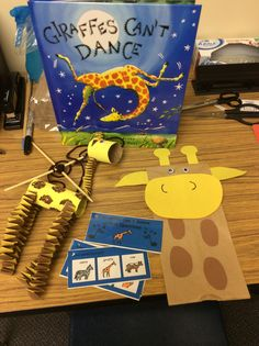Giraffes Can't Dance is a great book and lends itself to a ton of activities.  Shown: Giraffe marionette; paper sack puppet; WH questions