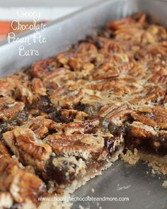 Gooey Chocolate Pecan Pie Bars-your favorite pecan pie loaded with semi-sweet chocolate and made into a bar for easy eating! #recipe