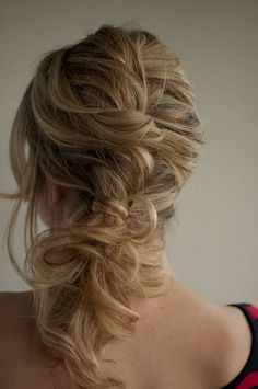 Undone french plait. Curl all hair all over. Create a loose french plait and tie with an elastic band. Undo until curls fall around a loose braid shape and tumble around the face.