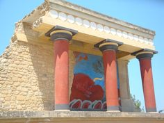 Charging bull fresco - The West Bastion. You can see a magnificent portico with painted bar relief of bull-catching scene at Knossos (Κνωσσός).