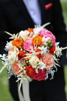 Pretty orange and pink bridal bouquet by Laurel Designs