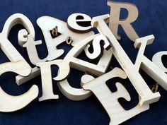 Cheap site to order wood letters that come in many fonts, heights and thicknesses.
