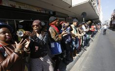 People form a human chain to pass donated food and clothes to a nearby shelter in celebration of Mandela Day in downtown Johannesburg, Nelson Mandela, Birthday Celebration, Shelter, Africa, Chain, Celebrities, People, Clothes, Food
