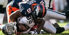 DENVER, CO - DECEMBER 13:  Running back Latavius Murray #28 of the Oakland Raiders looses his helmet as he is tackled by middle linebacker Todd Davis #51 of the Denver Broncos after a 3 yard first quarter carry during a game at Sports Authority Field at Mile High on December 13, 2015 in Denver, Colorado. (Photo by Dustin Bradford/Getty Images)