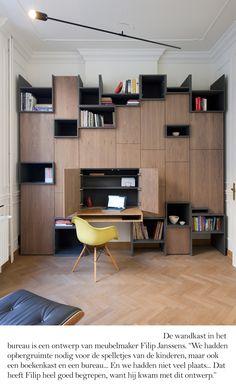 Modern workspace | Filip Janssen built-ins and a bright yellow #Modernica Shell Chair.