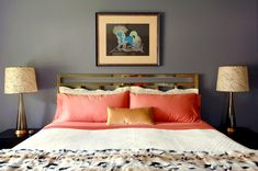 Deep blue grey walls, coral silk and gold details - elegant bedroom space