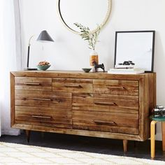Crafted from reclaimed pine, our Alexa Storage 7-Drawer Dresser imparts sophistication to naturalist style with its gently tapered legs and brass finished pulls.