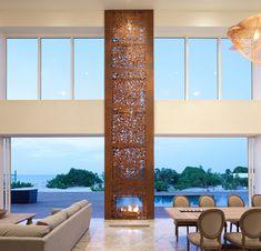 Unusual pierced faux chimney adds vertical interest to a neutral room. Bella Vita Villa. Prototype Design Lab design.