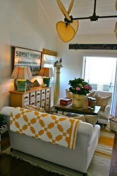 sweet living space - love the quilt and multi-drawer unit