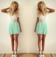 White top. Aqua skirt.