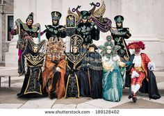 Carnival of Venice, beautiful group of masks at St. George island. - stock photo