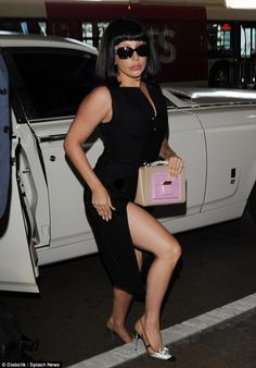 Showing some skin: Lady Gaga sported a daring black gown as she arrived at LAX airport on Sunday in Los Angeles