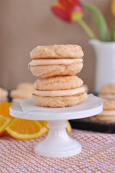 Orangesicle Sandwich Cookies - pinning this but I don't think I've ever seen the Creamsicle cake mix/frosting in the store.  Must investigate.  I've loved Creamsicles since I was a kid