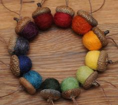 Rainbow Felted  Acorn Ornaments Set of 12, also available without hangers. $24.00, via Etsy.