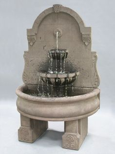 The Al's Garden Art Bavarian Wall Fountain with Plain Basin and Pedestals is just the right one for setting up a captivating and relaxing ambiance in your garden.