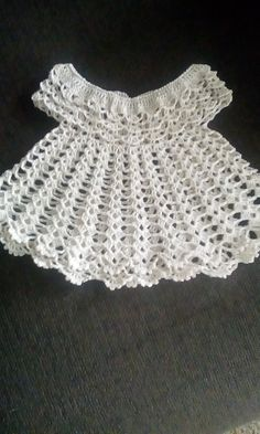 Crocheted doll dress. Can also be a special occasion dress for 6 month old.