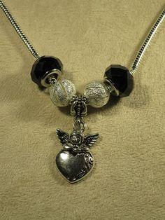 Colliers, Collier serpent Ange perles noires est une création orginale de les-bijoux-de-lynea sur DaWanda
