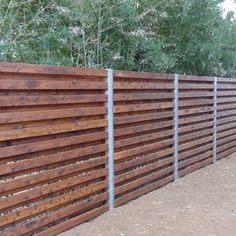 Viking Fence - cedar shadowbox fence with 4 in steel/zinc posts - installed in