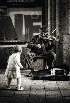 Street musician performs while a child dances. Black and white… Sponsored Sponsored ZsaZsa Bellagio. Street musician performs while a child dances. Black and white photograph. Life Photography, Vintage Photography, Children Photography, Photography Ideas, People Photography, Landscape Photography, Photography Colleges, Photography Lighting, Flower Photography