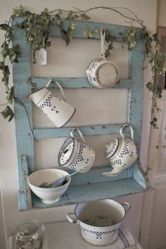 love the blue repurposed frame, but Ive never seen enamelware with blue checks before. Beautiful.
