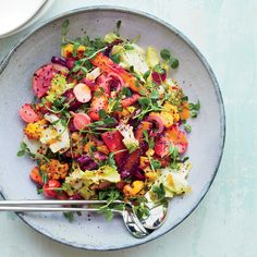 Vegetable Rainbow Salad   This vibrant salad showcases a colorful mixture of pickled onions and radishes, roasted root vegetables, leafy greens and black quinoa.