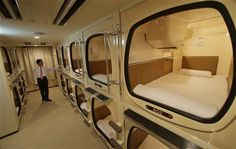 Squeezing into a capsule hotel room in Japan